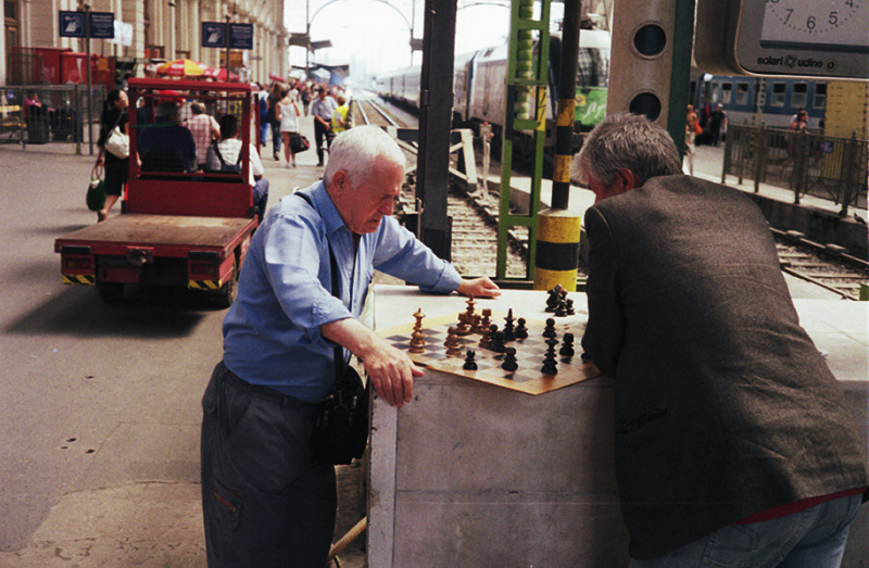 Old men playing chess in Budapest railway station
